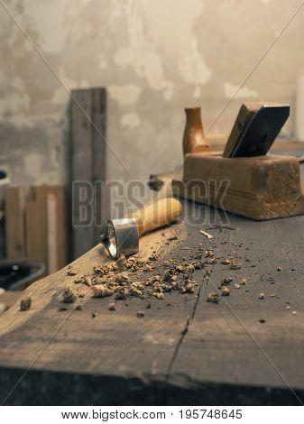Wood worker tools on an old workbench in a carpentry