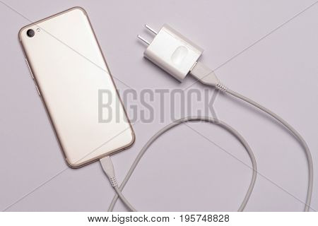 isolated of white smart phone charger with cable