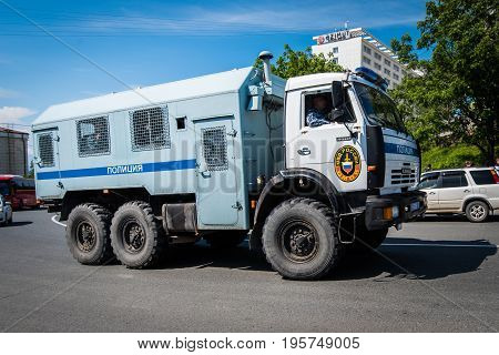 Vladivostok Russia - June 12 2017: The bus of group of police of a special purpose on the basis of the KamAZ-43114 car goes to the venue of a rally.