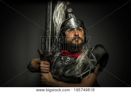 Legionnaire, Roman centurion with armor and helmet with white chalk, steel sword and long red cape