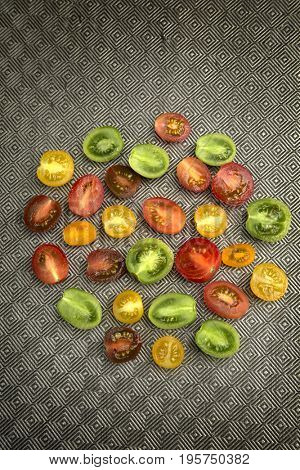 Various colored organics tomatoes in a circle