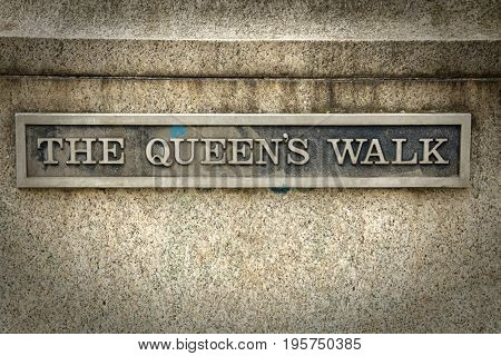 Queen's walk inscription in London.  Queen's Walk takes you over Westminster Bridge, along the south bank of the River Thames towards over the river on the Millennium footbridge to St Paul's Cathedral