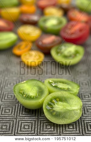 Various colored organics tomatoes cut in pieces