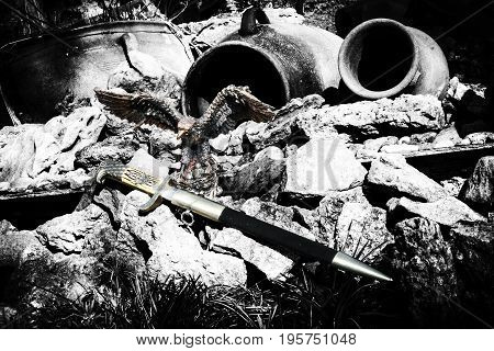 German dagger of the Nazi Reich and the Iron Eagle. Taken in nature among stones and jugs.