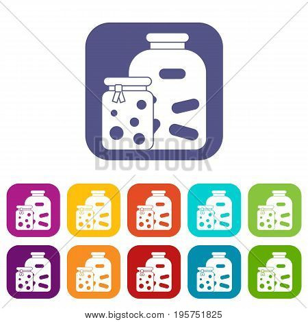 Jars with pickled vegetables and jam icons set vector illustration in flat style In colors red, blue, green and other