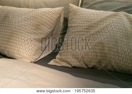 unmade messy bed room pillow and light green sheet relax morning concept