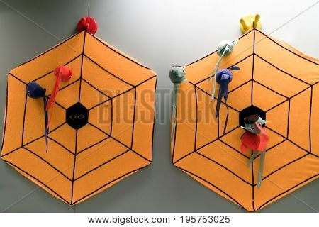 orange spider darts board on the wall for a kid