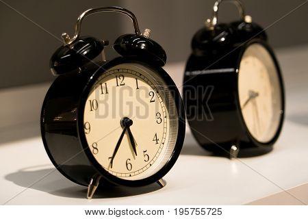 the alarm vintage clocks face on the table