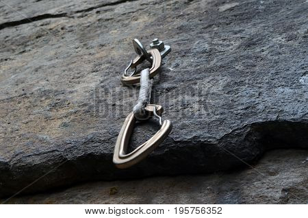 linking of the steel carabiners fixed in the rock,the carbine hammered into the rock