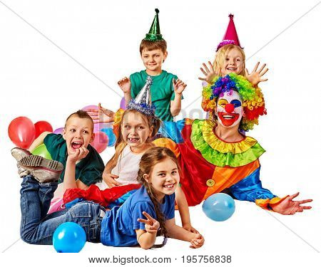 Birthday child clown playing with children and bunny fingers prank. Kid holiday cakes celebratory and balloons happiest day. Children at a children's matinee. Holiday for kids in kindergarten.