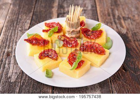 antipasto, polenta and dry tomato