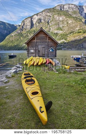 Canoeing in Norway. Fjord landscape with wooden cabin. Recreation background