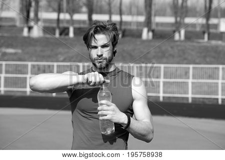 Handsome Muscular Man Holds Water Bottle