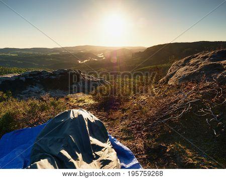 Sleeping In Nature In Sleeping Bag. Beautiful Awakening In  Rocks. View From Rocky Peak
