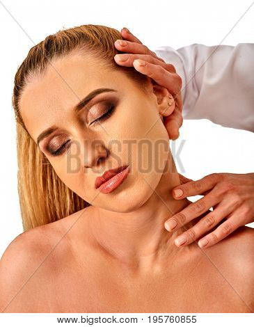 Shoulder and neck massage for woman in spa salon. Doctor making neck therapy in rehabilitation center on isolated. Direction of a dislocation in a specialized clinic.