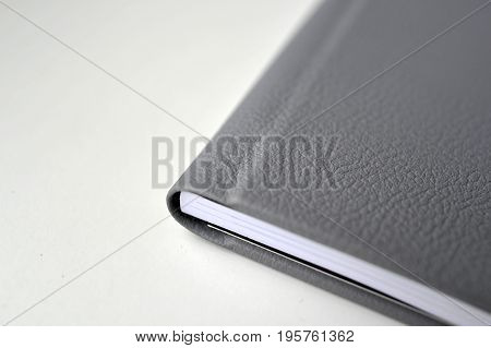 A black leather book cover print in photo book