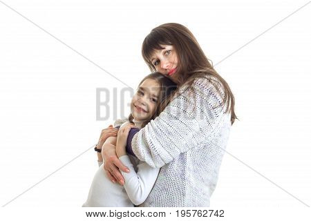 mother hugs with her little daughter in studio isolated onn white background