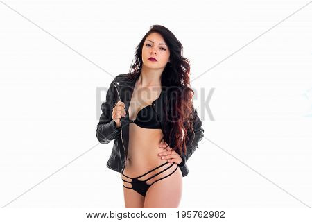 Brunette woman in leather jacket and lingerie looking at the camera isolated on white background
