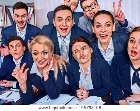 Mad business people office in high school celebrate successful passing exams. Team student college rejoice project. Men and women fooled to give bunny fingers prank. Group of graduates making selfie.