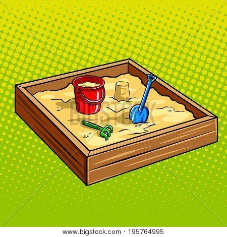 Sandpit for children pop art retro vector illustration. Sandbox with toys plastic bucket shovel and rake. Comic book style imitation.