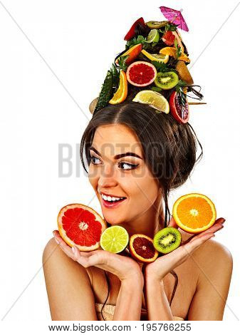 Hair mask from fresh fruits on woman head. Girl with beautiful face hold ingredient for homemade organic skin and hair therapy. Fruits are nicely laid out on palms. Anti-acne remover.