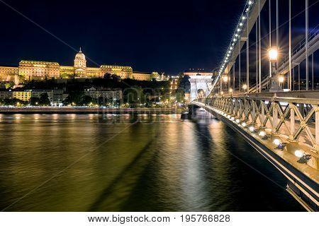 Famous Chain bridge Buda castle at night and river Danube in Budapest
