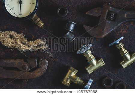 Old Wrenches And Water Gates On A Rusty Iron Background