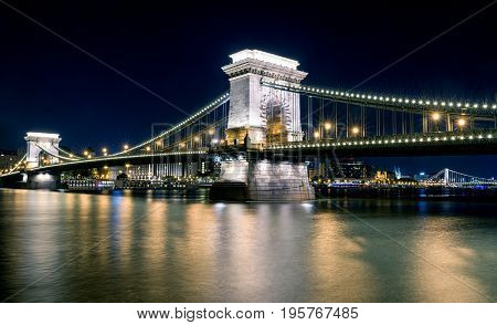 Famous Chain bridge at night and river Danube in Budapest Hungary