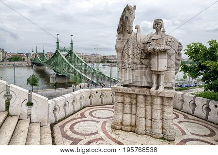 BUDAPEST HUNGARY - MAY 7: Statue on Gellert hill and Liberty bridge over river Danube on May 7 2017 in Budapest