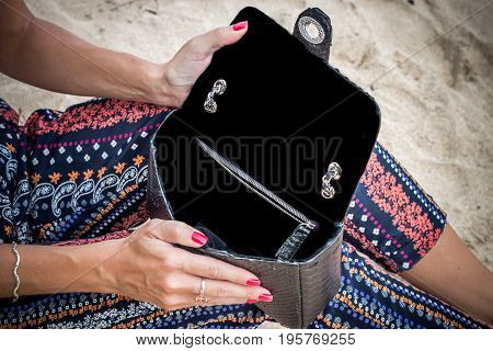 Close up of luxury handmade snakeskin python handbag in woman hands. Tropical Bali island. Indonesia.