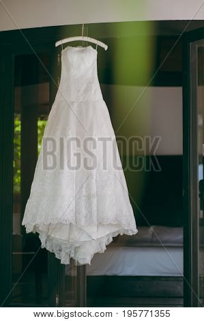 Beautiful Wedding Dress Hanging On The Door