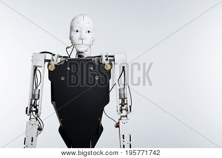 Robotic age. White elaborate complicated mechanism with artificial intelligence standing isolated on white background