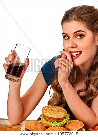 Woman eating french fries and hamburger. Student consume fast food on table. Girl drinks cola and dreams. Girl trying to eat junk. Advertise fast food on isolated. Disruption from diet idea.