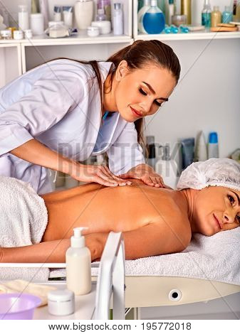 Massage room for therapy deals. Woman therapist making manual therapy back. Hands of masseuse treatment of spinal injuries 40 old client in spa salon. Woman rests in an elite spa salon.