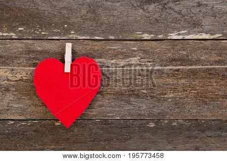 Red Felt Fabric Heart On Clothespin Against Rustic Old Wooden Background