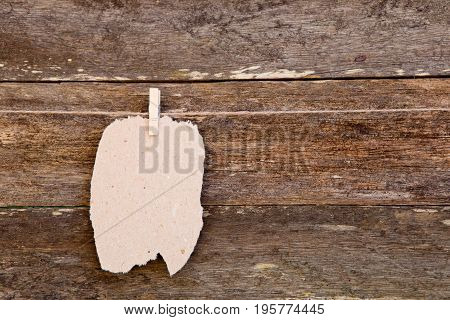 Torn Homemade Paper - Cardboard Label Hanging On Clothespin Against Old Wooden Background