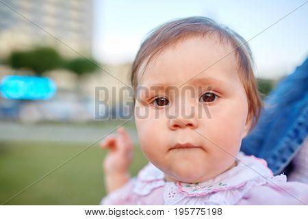 Sweet Beautiful little girl outdoors looking to the camera. Joyful, Happy, Excited. Closeup Headshot.