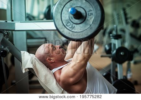 The man is doing an exercise for the chest
