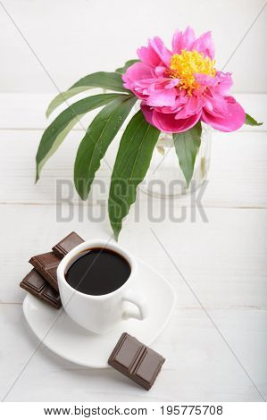 Vertical Shot Of Coffee And Flower Over White Wooden Background