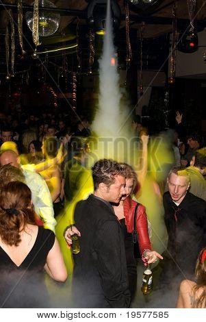 Foggy nightclub dance crowd