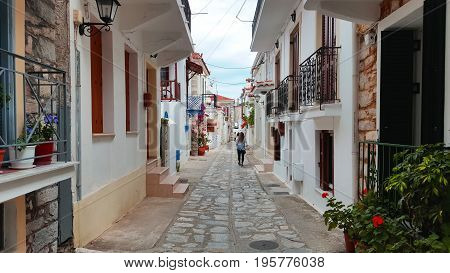 Street view of Skiathos town Greece traditional architecture summer day