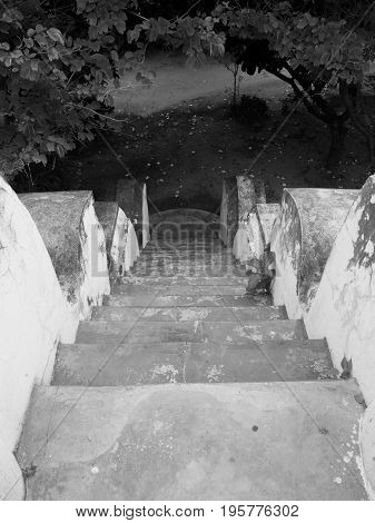 PHOTO OF OLD CONCRETE STAIR SEEING FROM TOP VIEW