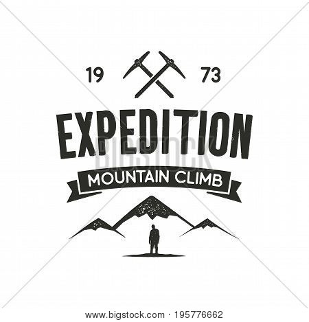Mountain expedition label with climbing symbols and type design - mountain climb. Vintage letterpress style. Outdoor activity emblem for t-shirt, mug, clothing print. isolated on white.