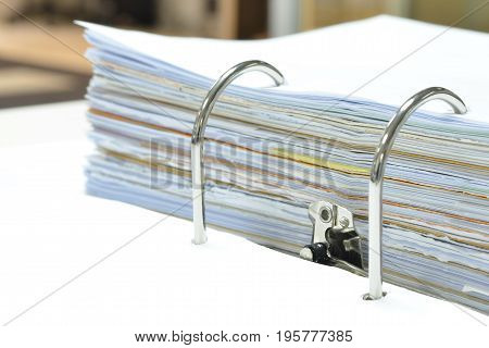 Pile of papers and documents in document fil on white table at workplace,business concept,office supplies.