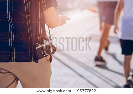 Man with classic photo camera on summer vacations