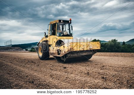 Vibratory Soil Compactor Working On Highway Construction Site