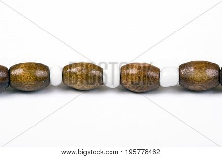 Necklace with wooden beads isolated on white background