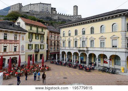 Bellinzona, Switzerland - 15 October 2014: People Walking And Sitting On Restaurants At Collegiata S