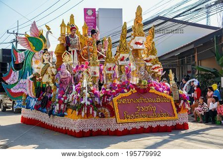 CHIANGMAI THAILAND - JANUARY 25 2015: Indigenous people with traditional costume on decorated vehicle with flowers in parade of 22nd Traditional Skirt Fabric and The Indigenous Product and Culture Festival in Mae Chaem Chiangmai Thailand