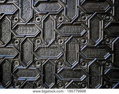 Close-up part of a gate at Seville Cathedral in Seville Spain.